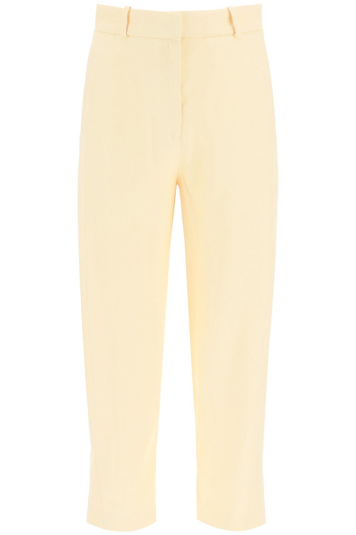 Toteme pantaloni in viscosa twisted seam