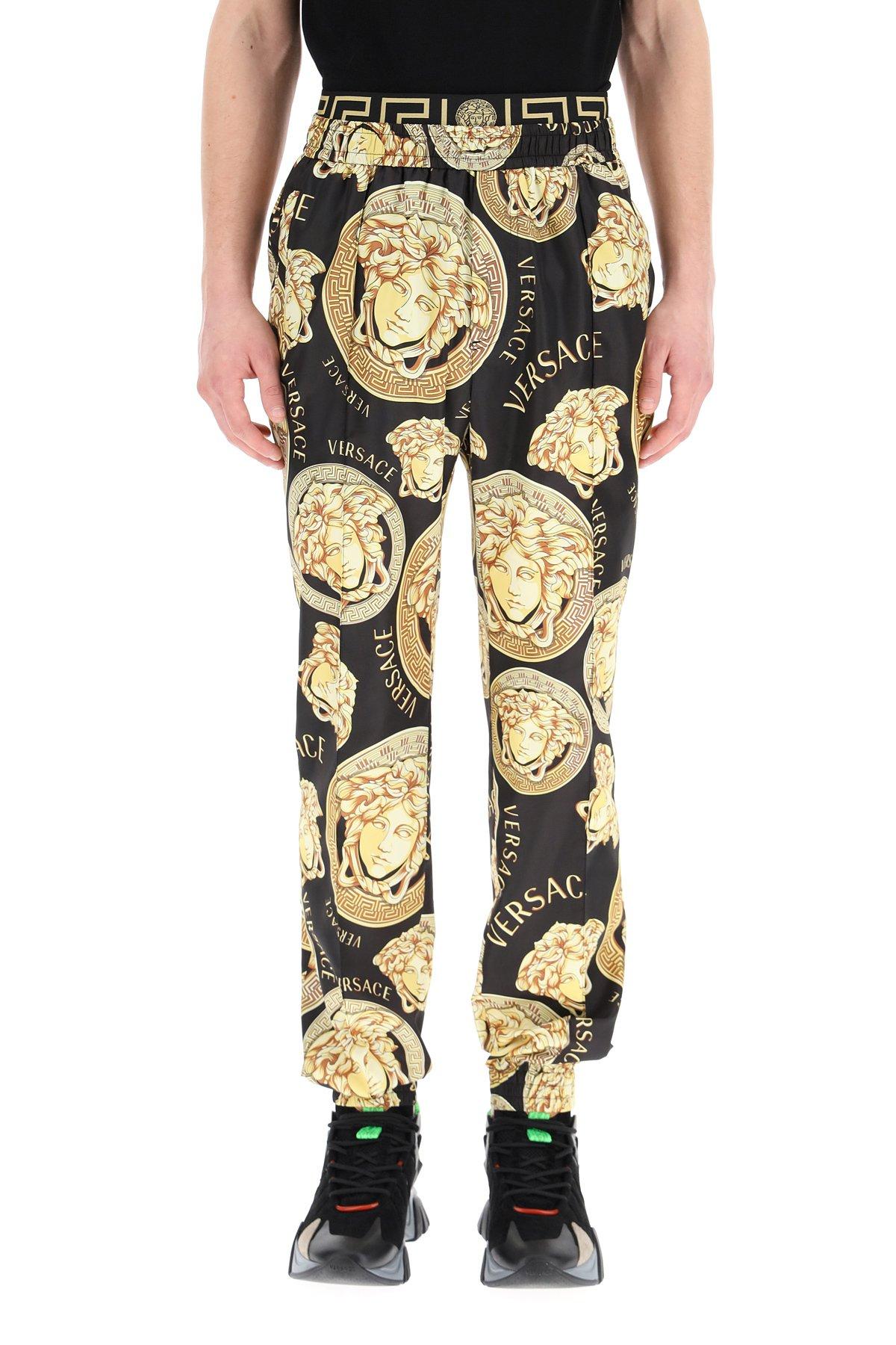 Versace pantaloni con stampa medusa amplified