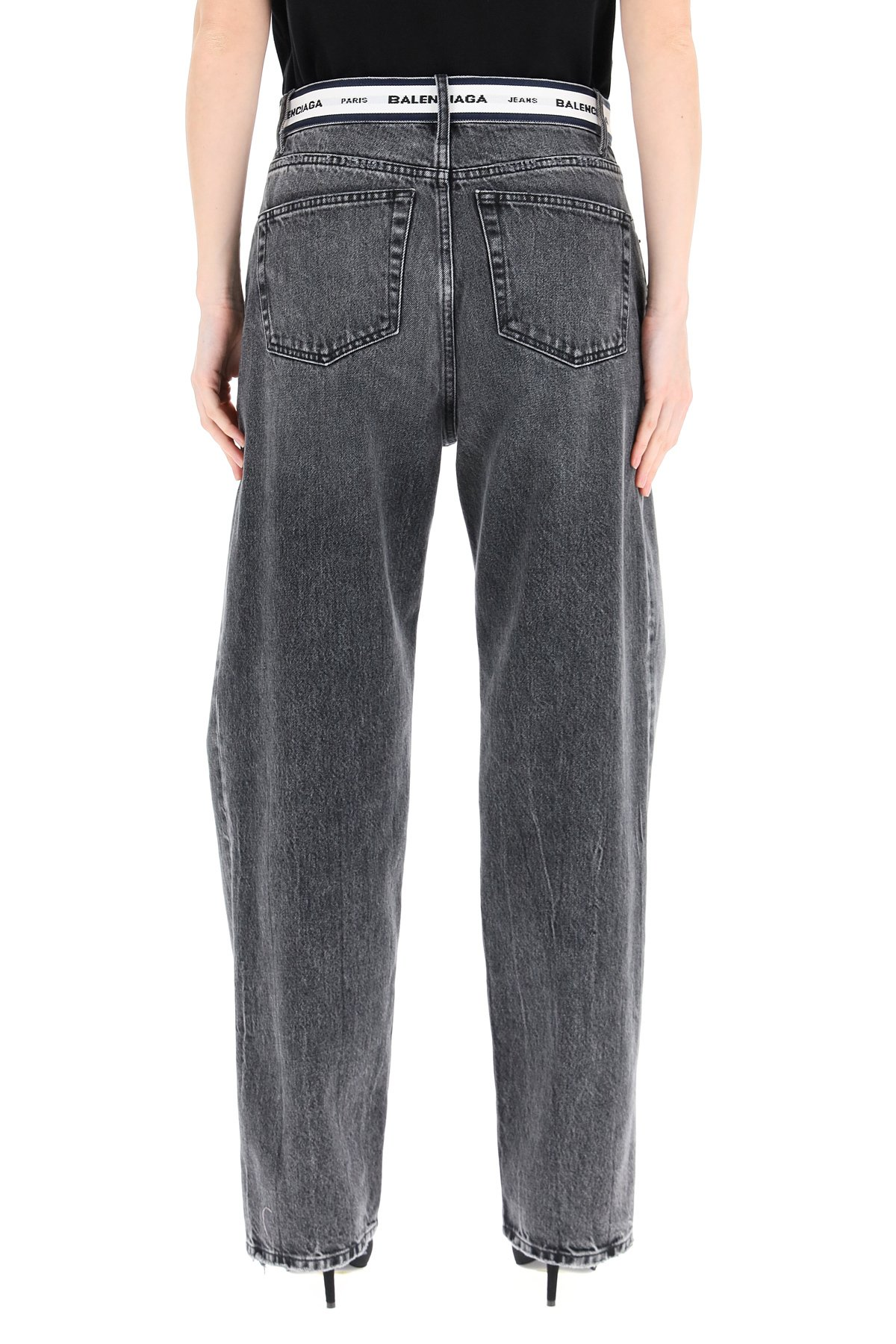 Balenciaga jeans con nastro monogram in vita