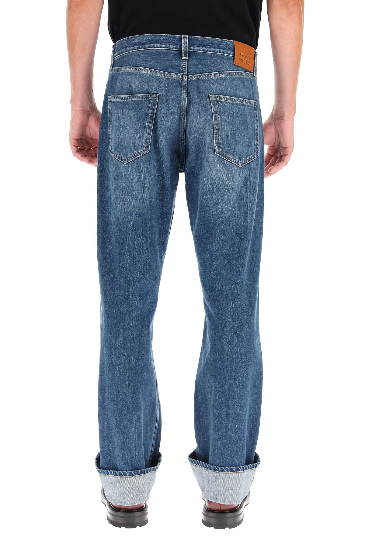 Alexander mcqueen jeans con cimosa decorativa