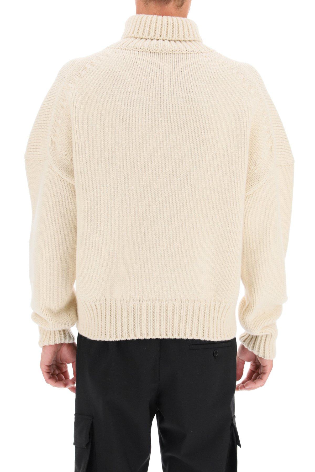 Alexander mcqueen maglione intrecciato con simbolo