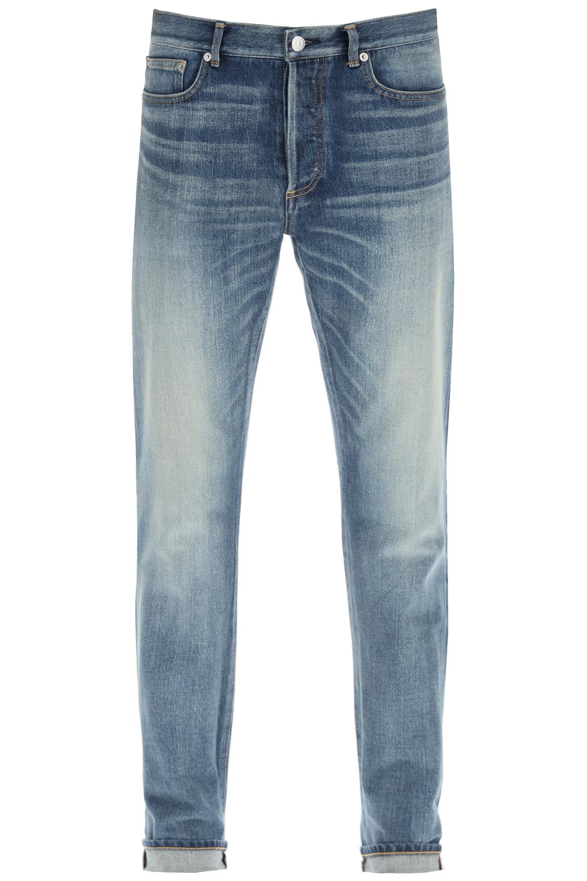 Dior jeans slim fit con cimosa logata